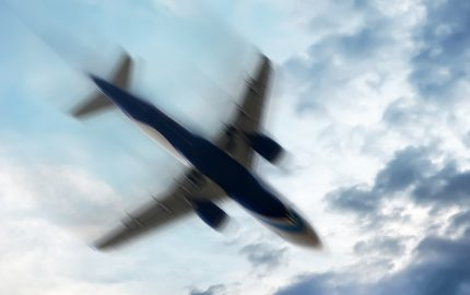 Airplane Shaking in the Sky (stock photo)