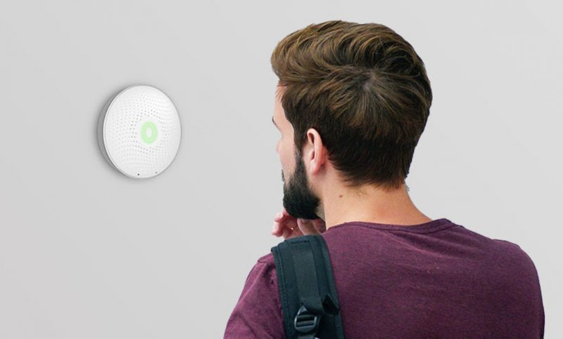 Man examining Airthings Wave Smart Radon Detector