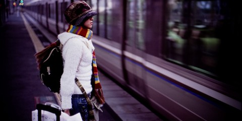 Solo girl on subway platform in Osaka, Japan