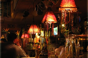 Person sitting at dimly lit bar in Spain