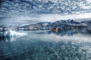 Small boat in the Arctic Sea near Eastern Greenland