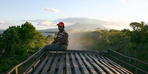 Man sits atop a chicken bus in Granada, Nicaragua