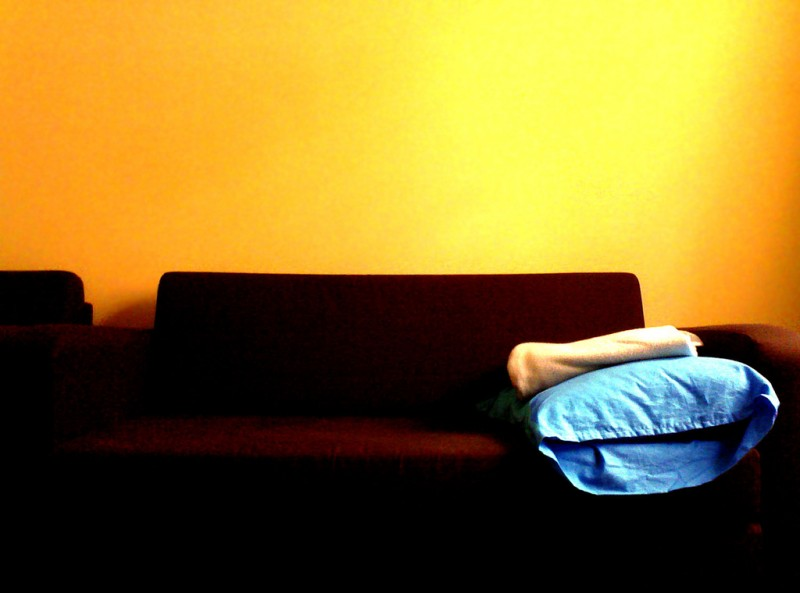 Blue pillow on an empty couch