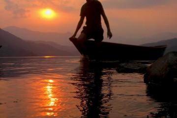Floating Boatman at Phewa lake, Nepal