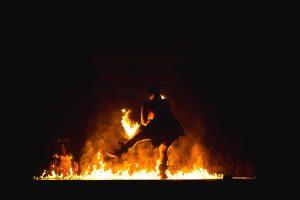 Man dancing in a bonfire ritual