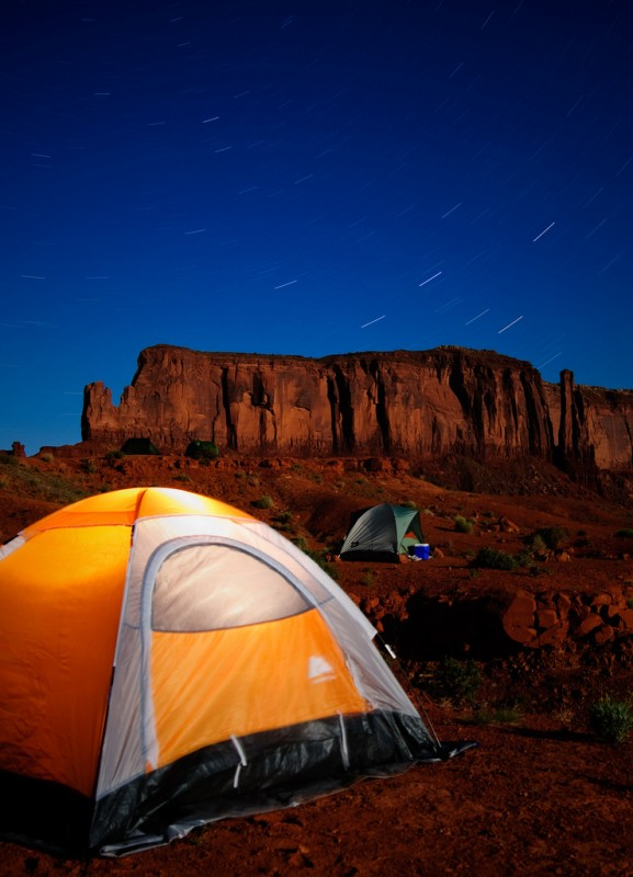 Two tents pitched under the stars in Monument Valley, Utah