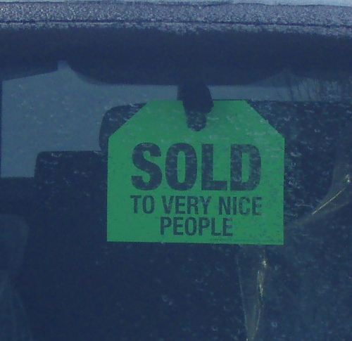 Sold sign in car window