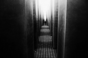 Child wandering inside the Holocaust Memorial, Berlin, Germany