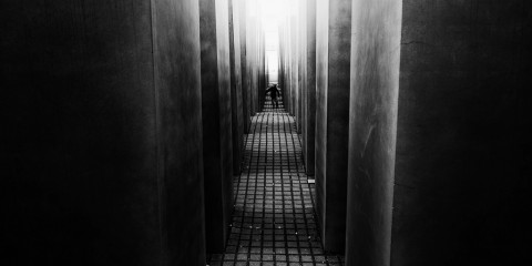 Child wandering inside the Holocaust Memorial, Berlin, Germany