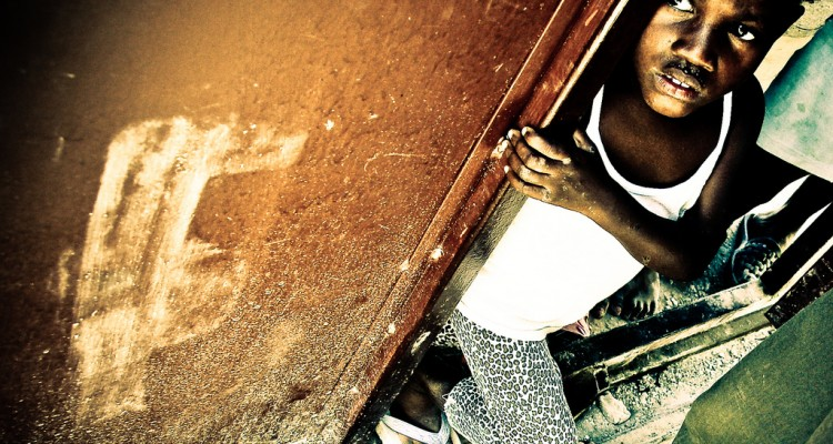 Child on the steps of orphanage in Haiti