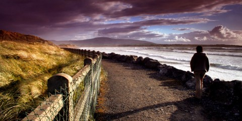 Person walking on the coast of Strandhill, Sligo, Ireland
