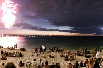 Comet, fireworks and lightning simultaneously over Perth, Australia
