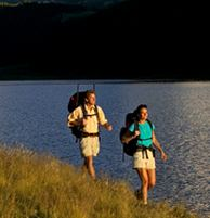 couple-hiking-along-lake