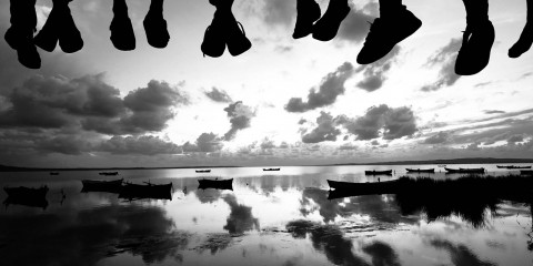 Silhouette of Dangling Feet