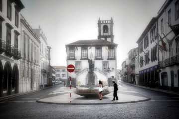 Man and woman alone on street in Sao Miguel, Azores, Portugal