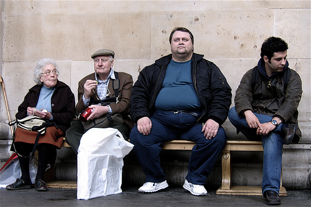 Four very different people on a bench in Camden, London