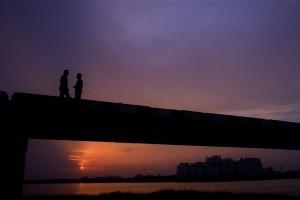 Friends on a Bridge at Twilight, Chennai, India