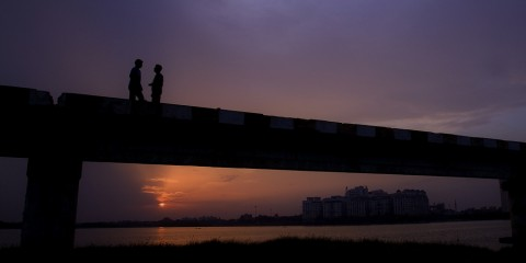 Friends on a Bridge at Twilight, India