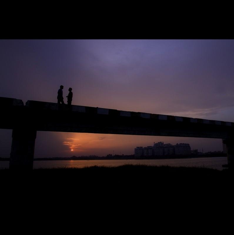 Friends on a Bridge at Twilight, India