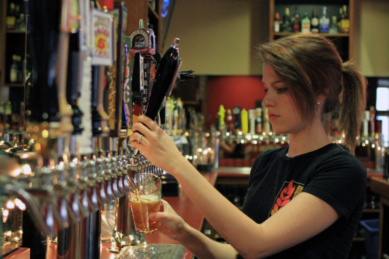Girl pouring tap beer at Harrisburg's Federal Taphouse