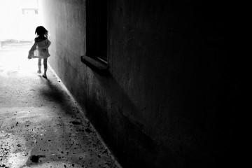 Girl running into the light in Switzerland
