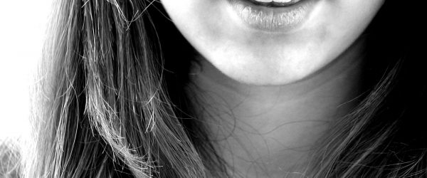 Girl smiling (closeup)