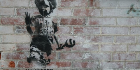 Graffiti on brick wall in Guildford, England