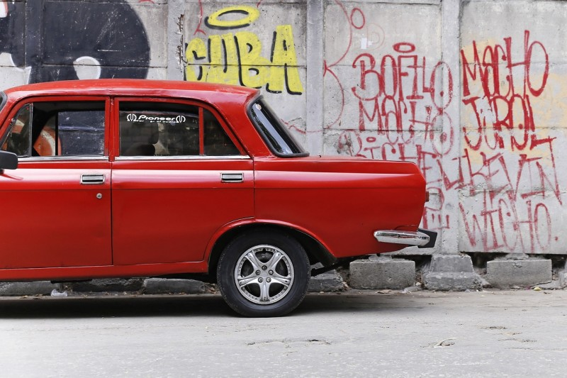 Graffiti and a Red Car in Cuba