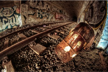 Trash and graffiti in a railway tunnel near Bergen, Norway