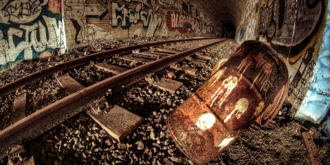 Trash and graffiti in a railway tunnel near Bergen, Norway