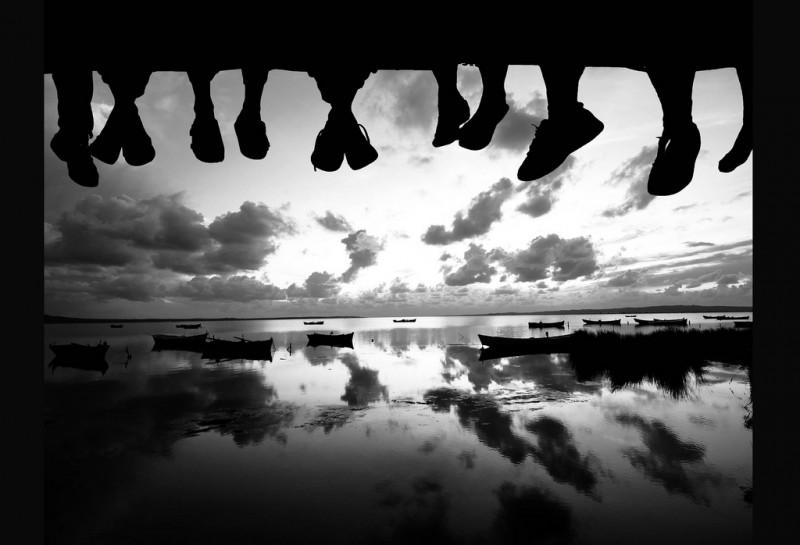 Feet dangling off a pier
