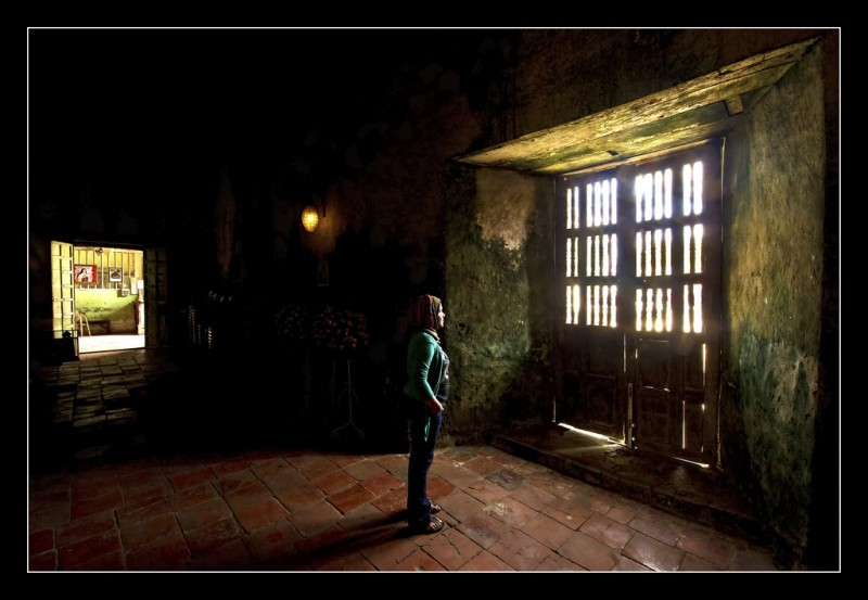 Woman standing Inside Baclayon Church, Philippines
