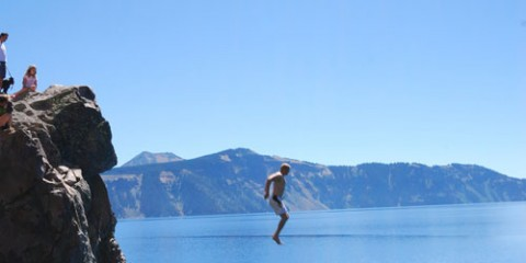 Man Jumping Into Crater Lake in Oregon