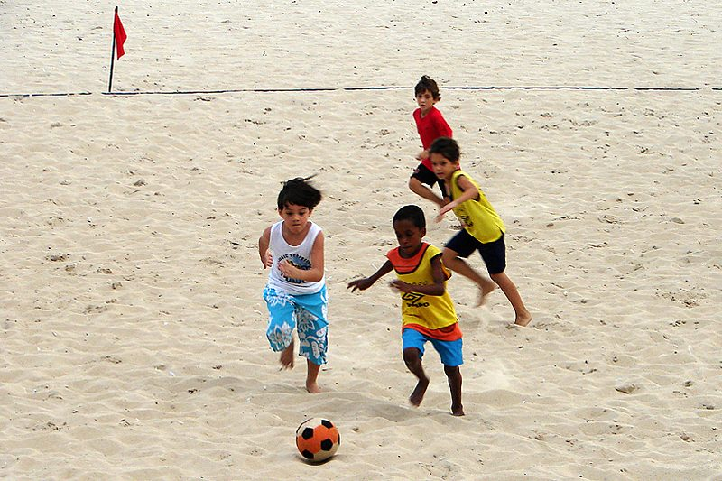Kids playing football on the beach in Ipanema, Rio de Janeiro, Brazil