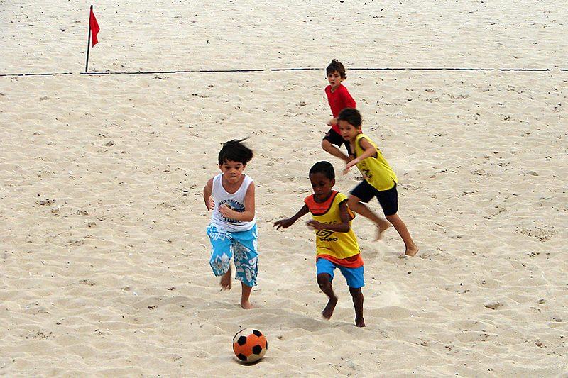 Kids playing football on the beach in Ipanema, Rio de Janeiro, Brazil