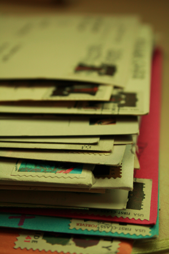 Stack of Letters from Friends / Stamped envelopes
