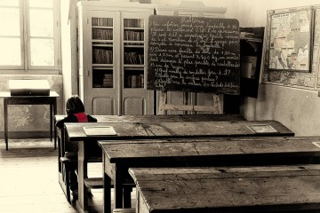 Lone Child in Classroom