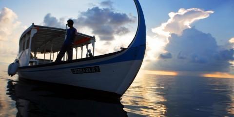 Man on a boat, Maldives