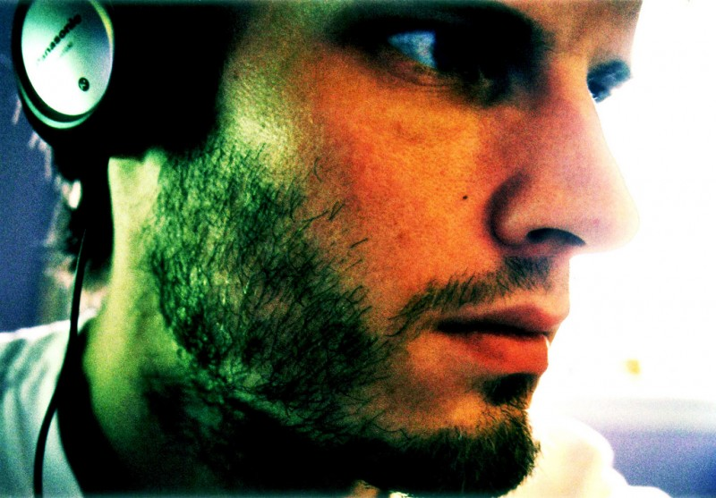 Man Listening to Headphones, Scotland (closeup)