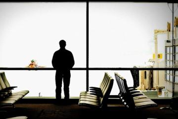 man-waiting-airport-ottawa-2313757724