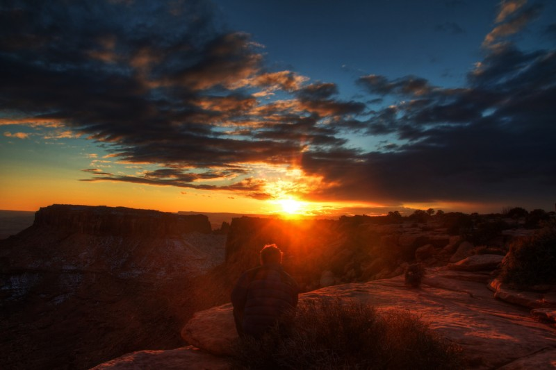 Man Watching the Sunset in Moab, Utah