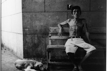Man with dog in Thailand