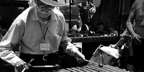 Man playing marimba in open market, Costa Rica