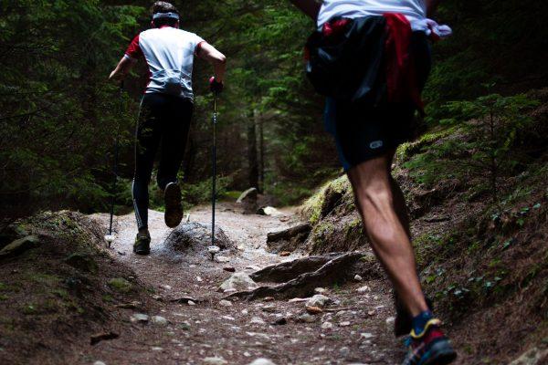 Two men trail running