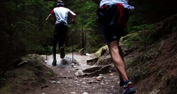 Two men trail running