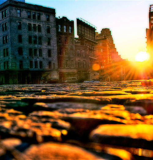 Ground level looking into the sunrise in the meat packing district in NYC