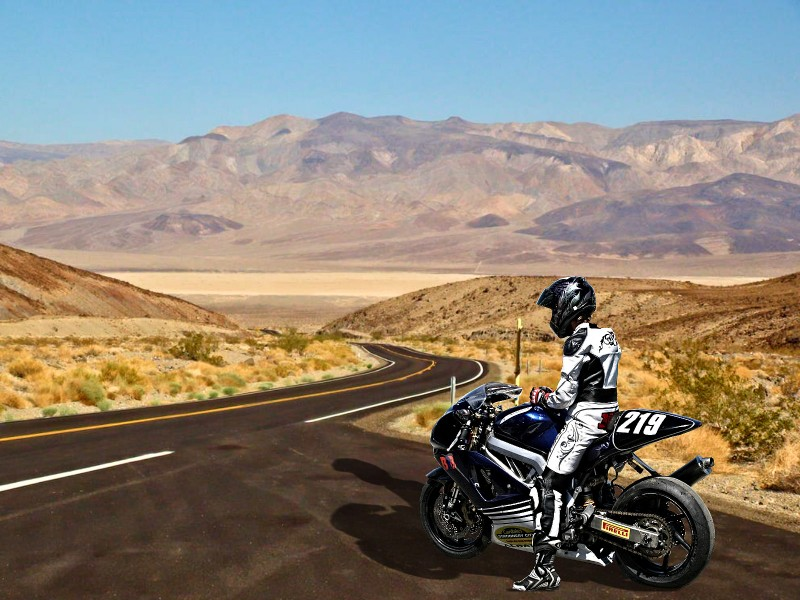 Motorcycler on open road in Spain
