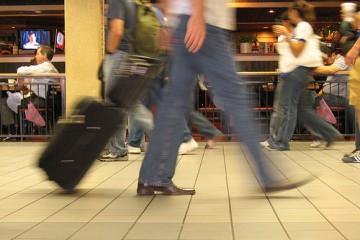 Blurry Traveler Moving through Airport