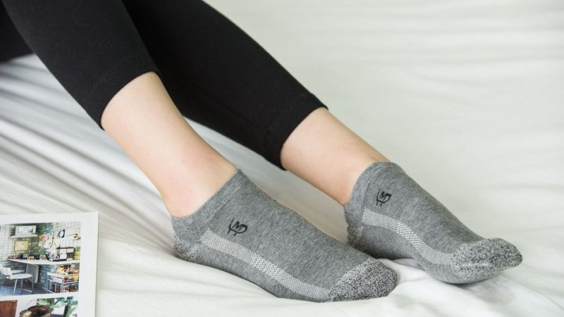 Woman in bed wearing MP Magic Socks