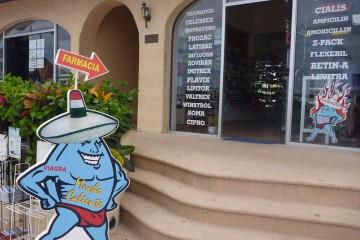 Sign: Farmacia de Mucho Caliente, Cabo San Lucas, Mexico